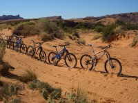 Solo mountain bikes on Poison Spider in Moab, big sand traps
